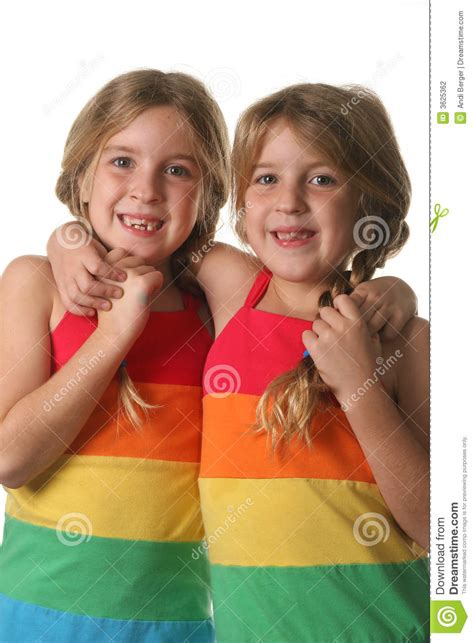 twlin sis twin sisters hugging vertical stock photography image