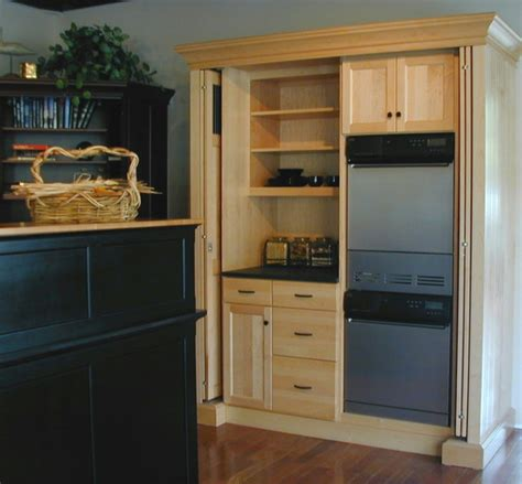 Laundry Armoire by Armoire Hides Laundry And Pantry Eclectic Laundry Room