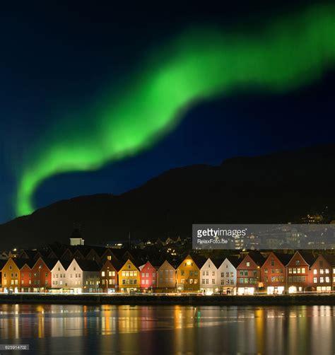 northern lights aurora borealis over bryggen in bergen