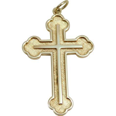 14 karat yellow gold cross pendant from edbergjewelry on