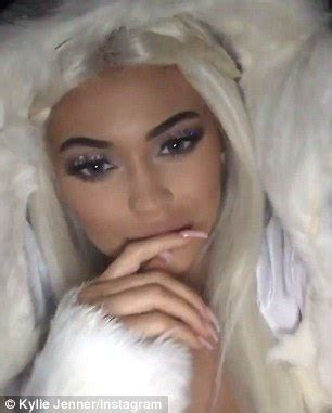 kylie jenner rocks blue eyes and white hair as she turns