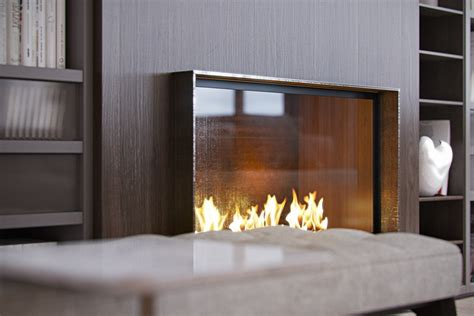 glass fireplace 4 modern homes with amazing fireplaces and creative lighting