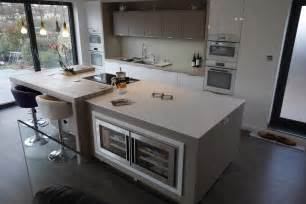 kitchen island worktops mix of corian and spekva wood designed by by design and fabricated by counter production