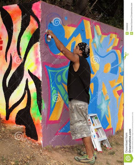 spray paint in wall spray painting the wall editorial photography image of
