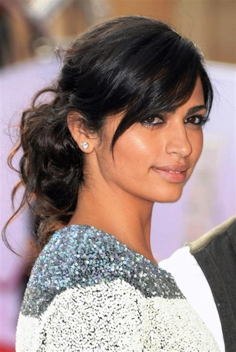 black hairstyles with swoop bangs camila alves easy black updo with side swept bangs for