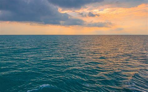 nx sunny sea sunset ocean water nature wallpaper