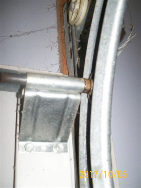 How Can I Adjust An Extension Spring Single Car Garage Garage Door Adjustment Do It Yourself