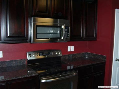 dark red kitchen cabinets 13 best images about updating rooms on pinterest transitional kitchen orange accent walls and