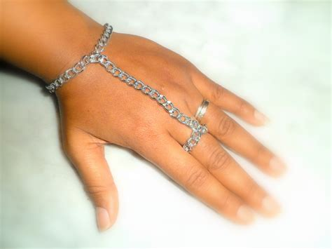 chunky silver adornment attached ring and bracelet