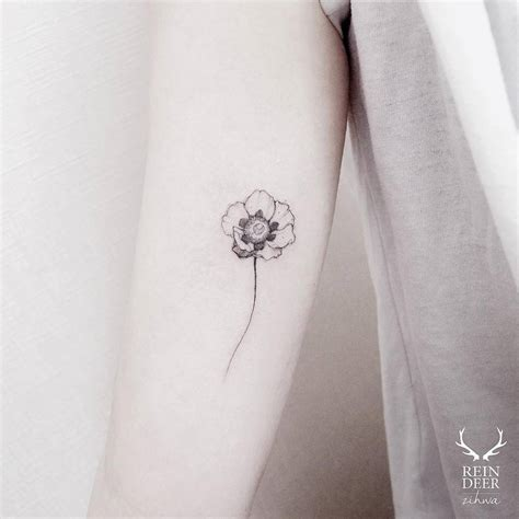 15 of the smallest most tasteful flower tattoos