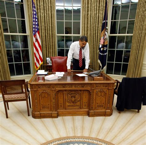 presidential desk in oval office file barack obama behind resolute desk jpg wikimedia commons