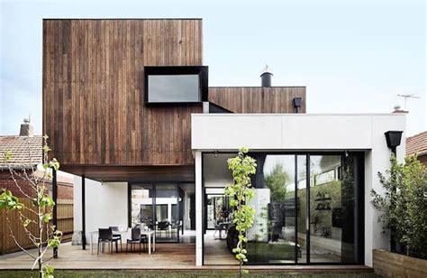 glass walls define  open living area   modern