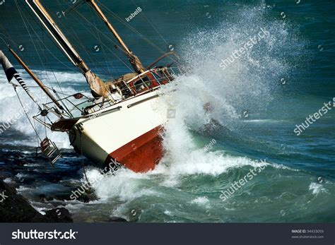 crash boat weather yacht crash on the rocks in stormy weather stock photo