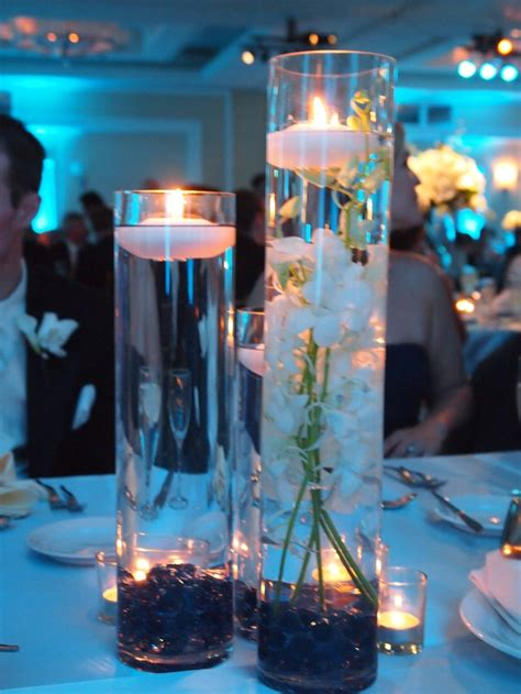 3 tiered vases with candles as centerpieces masquerade