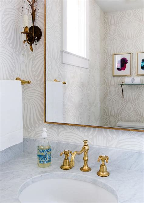 powder room with farrow and ball lotus wallpaper and gold