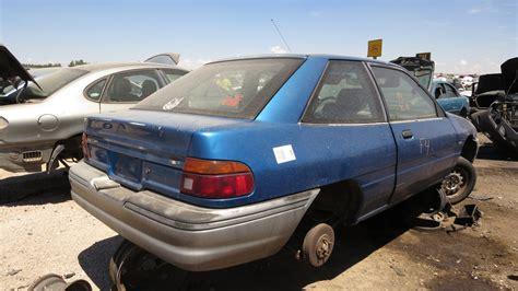 junkyard find 1990 ford escort pony 24 cars blue sky junkyard find 1991 ford escort pony