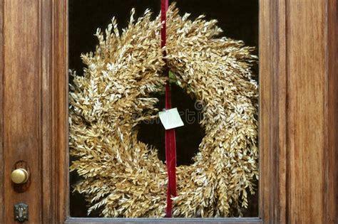 front door   glass insert   wreath  dry