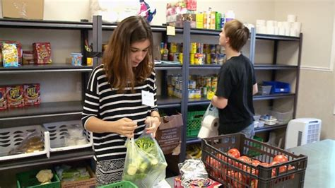 new year food donation trick or eat volunteers collect non perishable items on