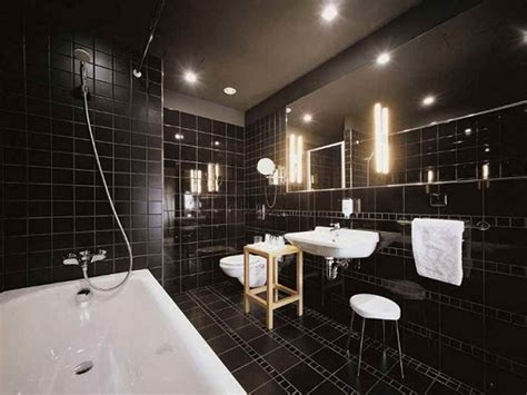 black bathroom tiles creating a stylish bathroom wall tiles design with black