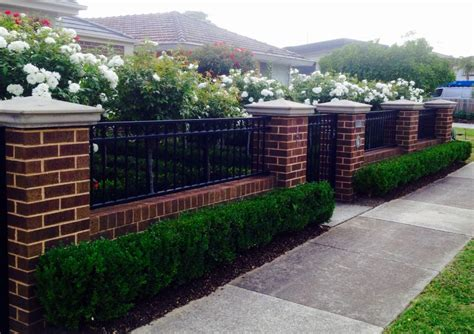 low brick fence with pillars and box hedge boarder ben s