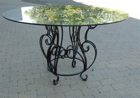 black wrought iron base glass top dining table