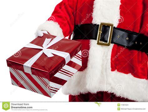 santa claus giving christmas presents stock photo image