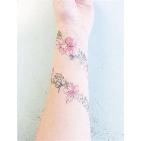 healed flower bracelet tattoo