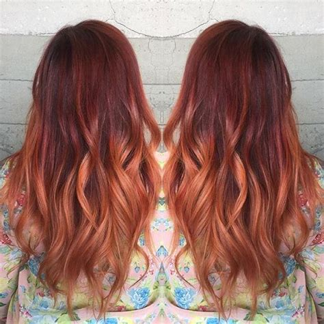 best place for balayage in austin client loving red color melt by leslie austin
