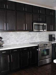 Kitchens With Backsplash Dark Birch Kitchen Cabinets With Shining White Quartz
