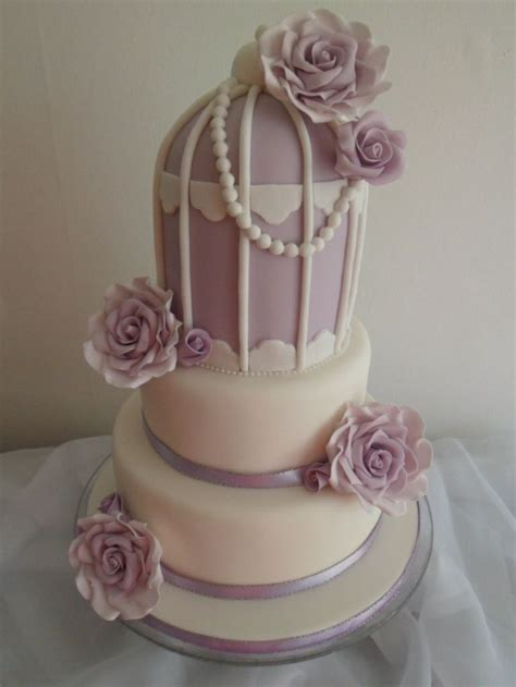 rose themed cake birdcage themed wedding cake with lilac sugar roses and
