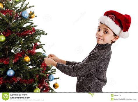 boy decorating christmas tree stock photo image 34347776