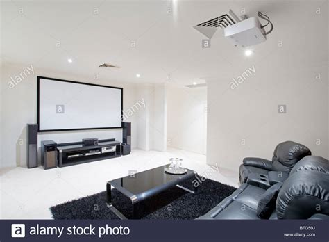 Ceiling Projector Living Room Home Theater Room With Black Leather Recliner Chairs