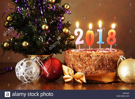 new year 2018 still life chocolate cake and artificial