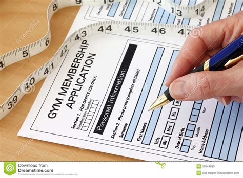 completing a gym membership application stock photo