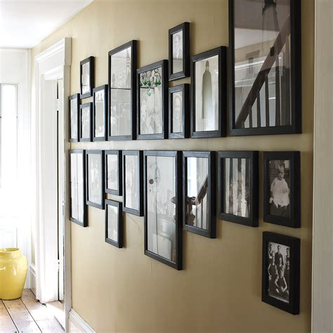 what can you use to hang pictures instead of nails weekend project create gallery walls martha stewart