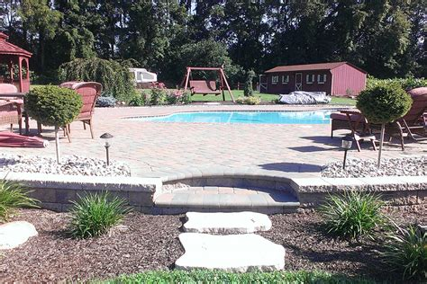 Pool That Turns Into A Patio by Swimming Pool Patio Design Ideas And Supplies For Pa Md