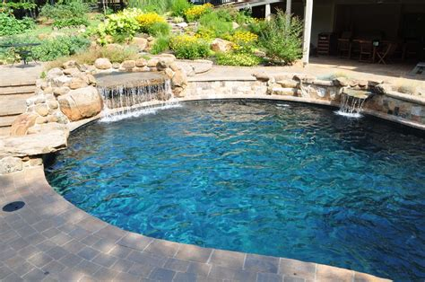 pool waterfall problemcustom pool builder questions lagoon style pool with bubblers two story fireplace low