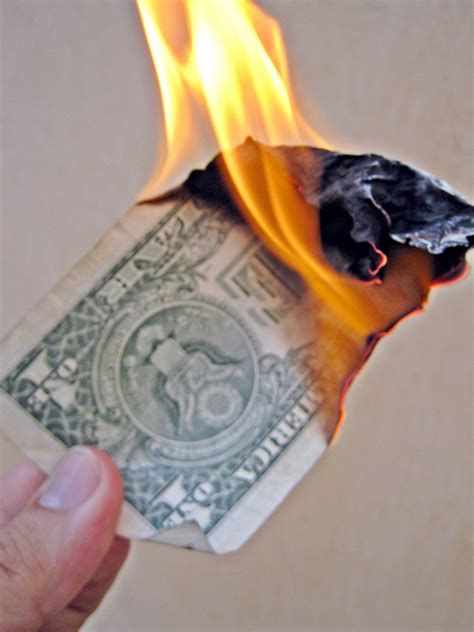 burning money for new year burn money a 1 bill burning up like much of our work