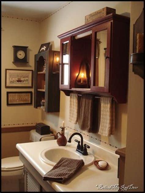 medicine with towel bar 1000 ideas about primitive bathroom decor on pinterest