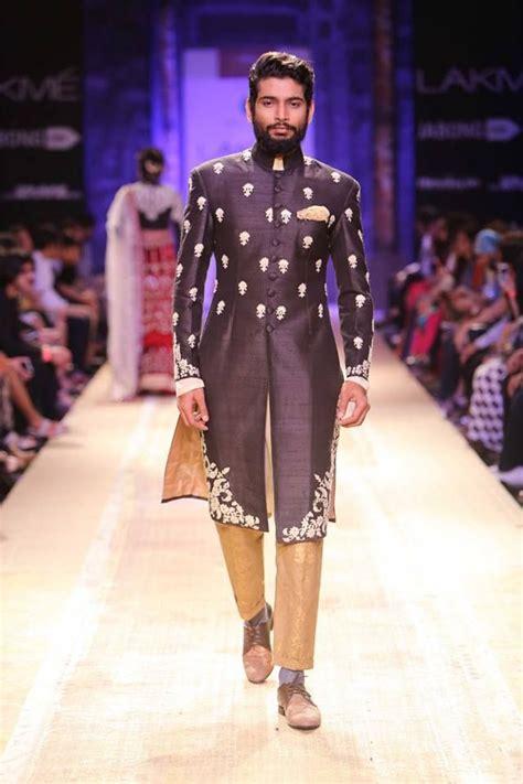 Dress Modis Nikky Style black and gold indian s sherwani by anju modi at lakme fashion week winter 2014 more here