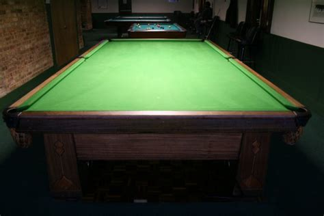 regulation pool table sizes what is the regulation or standard size for a pool billiards or snooker tables 4poolplayers