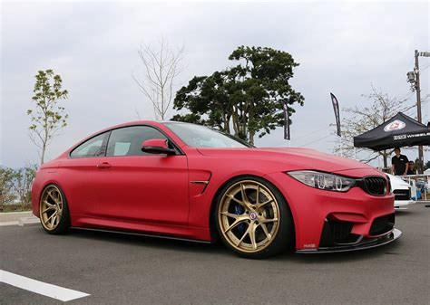 red bmw m4 access evolution matte red bmw m4 with hre wheels