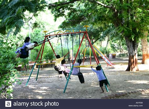 kids swing india children boys and girls playing and enjoying on swings in