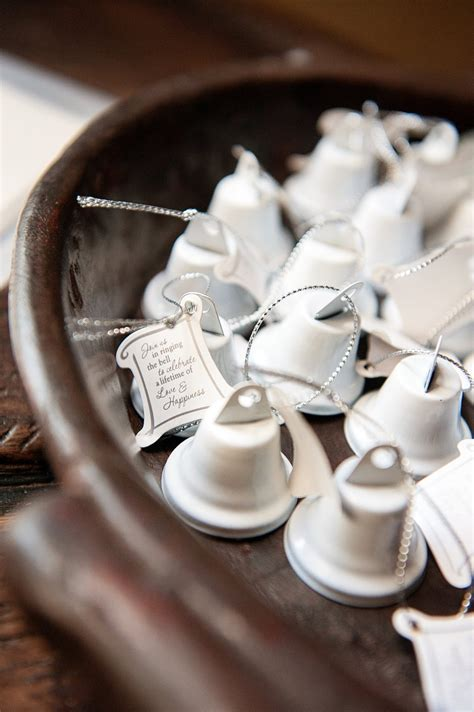 favors gifts photos white bells to ring at wedding