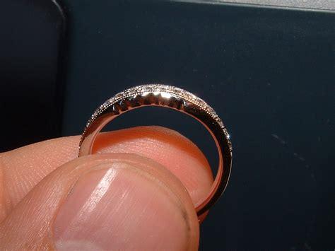 pin interlocking engagement and wedding rings on