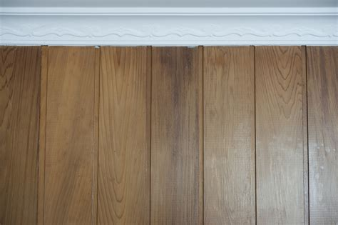 brown paneling image of wall covered with brown laminate panels freebie