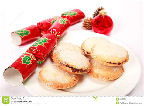 mince pies with christmas crackers royalty free stock