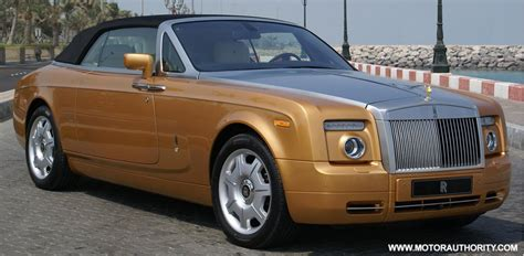 golden rolls royce golden rolls royce phantom drophead coupe lands in abu dhabi