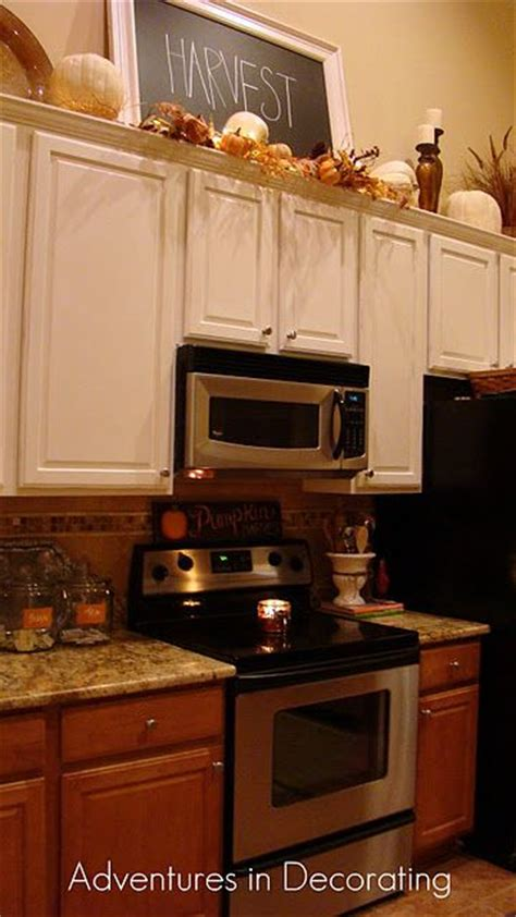 how do i decorate above my kitchen cabinets la z boy best 25 above cabinet decor ideas on pinterest top of