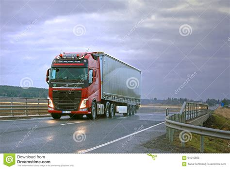 red volvo truck red volvo fh semi and dark sky editorial image image